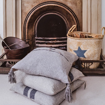 cushions and log basket from Moyseys