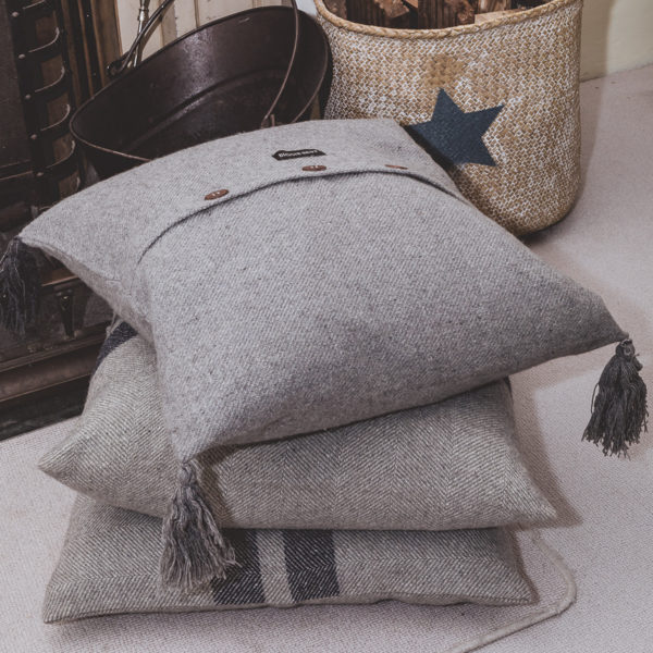 Grey wool cushion with buttons
