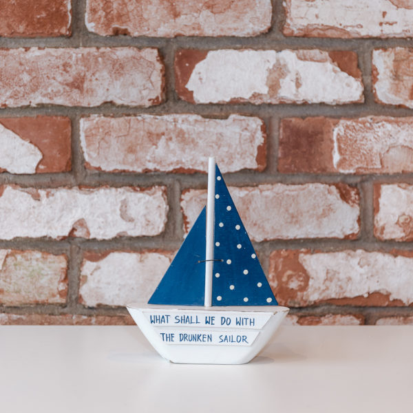 Blue and white sail boat