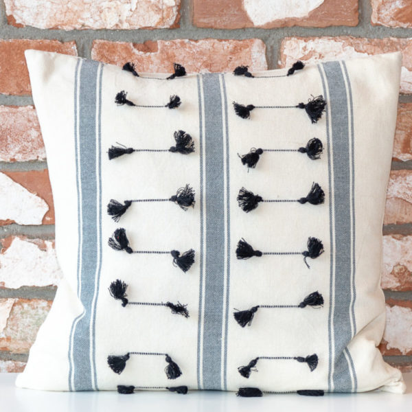 Stripe and tassles cushion